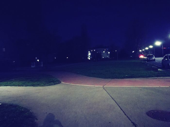 Illuminated road in city at night