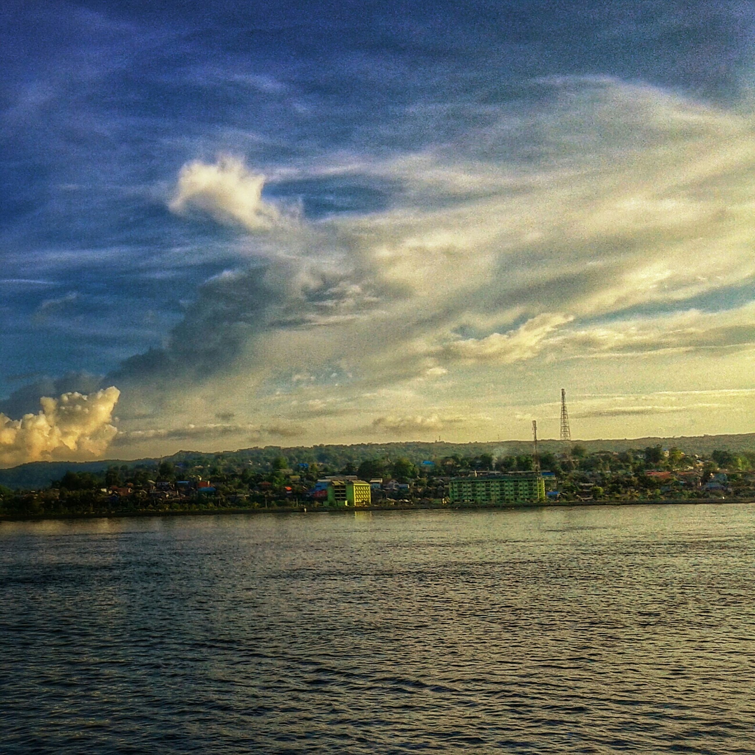 waterfront, water, sky, cloud - sky, scenics, rippled, tranquility, river, tranquil scene, sunset, cloud, sea, beauty in nature, nature, built structure, cloudy, architecture, building exterior, outdoors, idyllic
