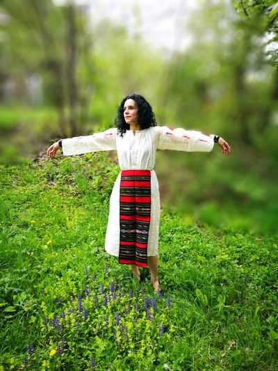 Woman In national dress Arms Outstretched Grass One Person Bulgarian Folklore only women Outdoors Full Length Day One Young Woman Only Portrait Freshness Real People Women Nature People Young Women