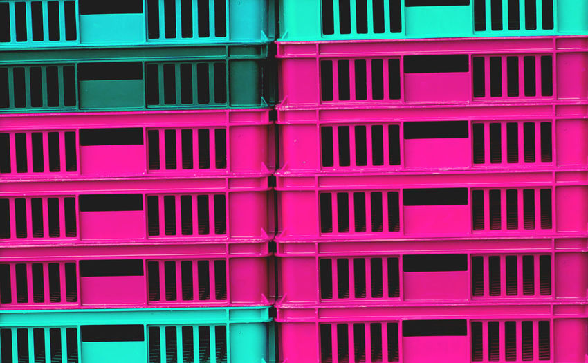 Full frame shot of pink and green crates for sale at market