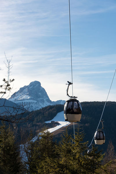 cable railway in the dolomites Cable Railway Cable Cold Temperature Funicular Mountain Mountain Range Nature No People Outdoors Ski Lift Sky Snow Snowcapped Mountain Tree Winter