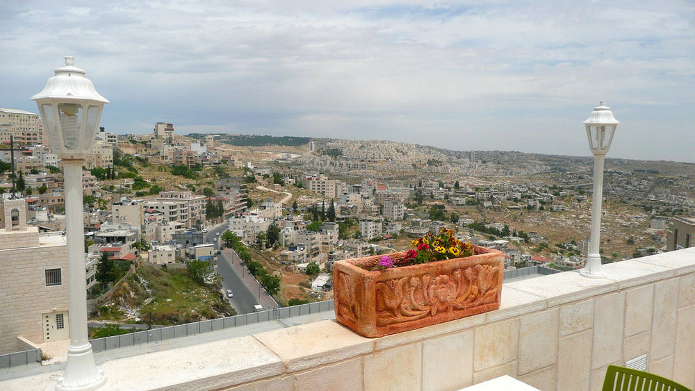 View over the city of Bethlehem in Palestinian Territory from a hill Architecture Balcony Bethlehem Building Exterior Built Structure City Cityscape Day Dome Horizontal Houses Nature Near East No People Outdoors Palestine Palestinian Territory Place Of Worship Settlement Sky Terrace Tower