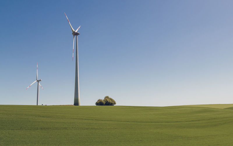 Environment Wind Turbine Turbine Environmental Conservation Renewable Energy Alternative Energy Wind Power Fuel And Power Generation Landscape Sky Grass Field Rural Scene Land Beauty In Nature Green Color Day Nature No People Copy Space Outdoors Sustainable Resources Power In Nature