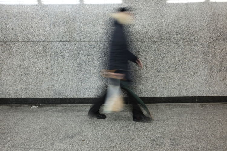 person blurred in the underpass Commuter Blurred Motion Blurry Concept Day Defocused Full Length Indoors  Leisure Activity Lifestyles Long Exposure Low Section Men Motion One Person People Real People Speed Unrecognizable Person Urgency Walking