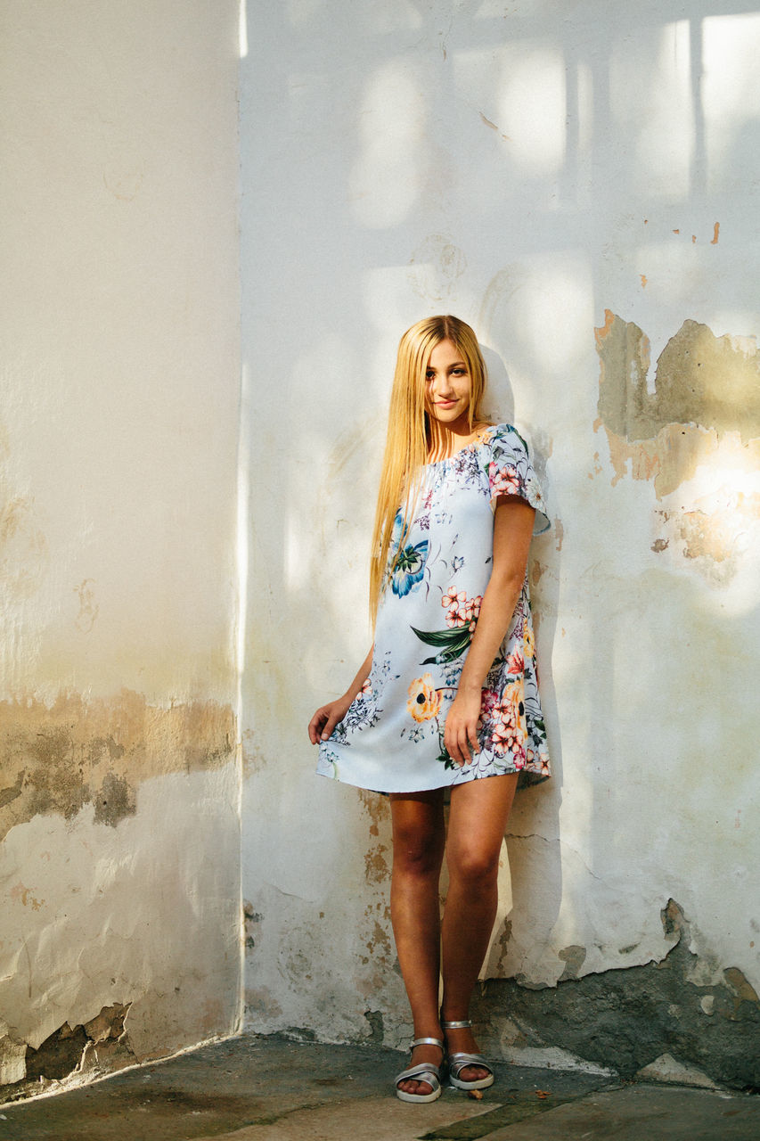 real people, full length, standing, one person, young adult, young women, leisure activity, front view, casual clothing, looking at camera, lifestyles, portrait, beautiful woman, posing, fashion, day, blond hair, indoors, architecture