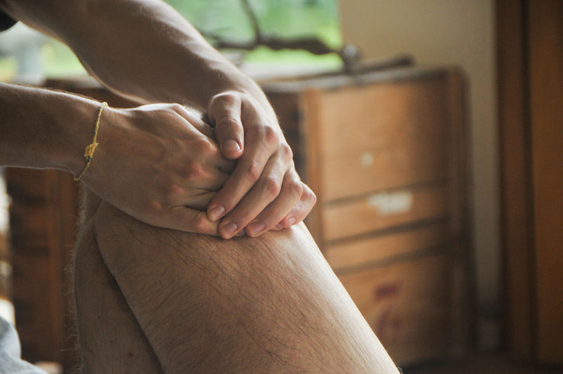 Cropped Image Of Therapist Massaging Man At Spa