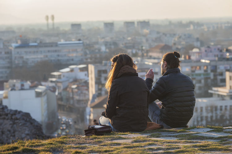 Rear view of couple looking at cityscape