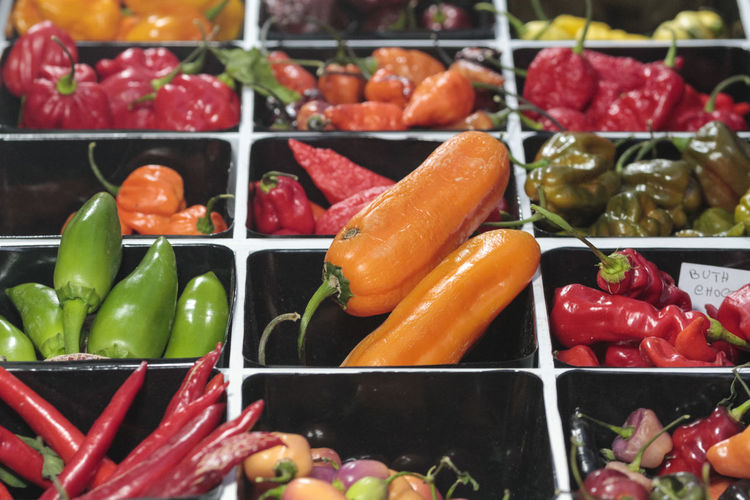 Spicy chili peppers of various colors, sold at market