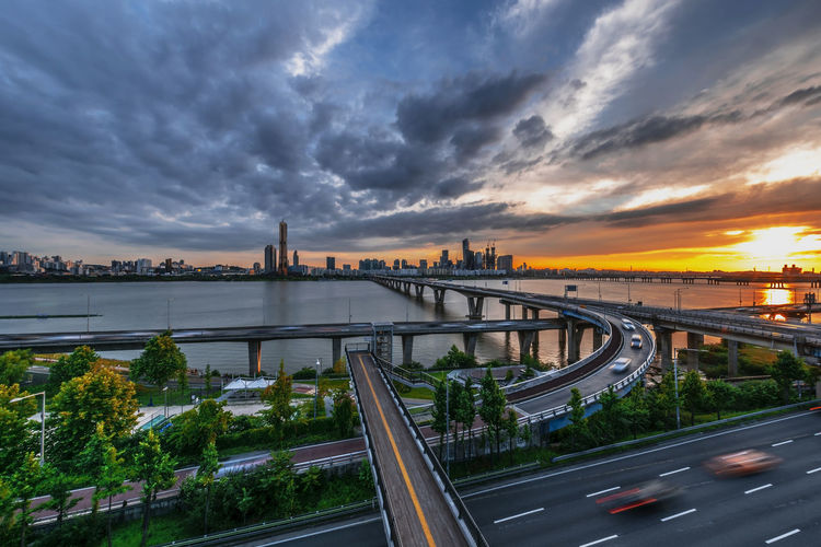 Panorama, Seoul city and Downtown skyline in Seoul, South Korea. Architecture Bridge Bridge - Man Made Structure Building Exterior Built Structure City Cityscape Cloud - Sky Connection Dusk Motion Multiple Lane Highway Nature No People Outdoors Road Scenics - Nature Sky Street Sunset Transportation Water