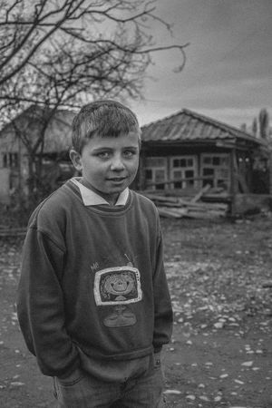"""""""In Exile"""" is a documentary portrait series of Molokans. Molokans are a Spiritual Christian religious group of Russian origin rejected more than two hundred years ago by Orthodox Church and exiled in the country of Georgia. They live in the east part of Georgia in the village of Ulianovka. After the collapse of the Soviet Union, many of them came back to Russia; also, their young generation left there to find a better job and lifestyle opportunity in the other parts of Georgia, and just a few of them(around 10 families) still live in this small territory. A small and old community which will be forgotten forever. Documentary Storytelling Blackandwhite Monochrome Travel Places Village Real People Real Person Photography Daily Life Life Style Looking Photojournalism Journalism Documentary Photography Human Body Part Human Face Human Representation person History Smile Exile Molokans Portrait Childhood Boys Looking At Camera Elementary Age Children The Photojournalist - 2018 EyeEm Awards The Portraitist - 2018 EyeEm Awards The Traveler - 2018 EyeEm Awards"""