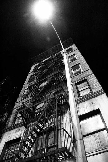 brownstone in soho Brownstones NYC Architecture Building Exterior Built Structure Devin Delano Fire Escape Low Angle View Moon Night No People Outdoors Sky Steps And Staircases