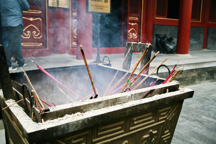 Incense burning in a Beijing temple Buddhism Buddhist Temple Burning Incense Smoke Religious Festival China Beijing City Place Of Worship Spirituality Incense Religious Equipment Religious Offering Altar Ash Historic Shrine Religion Temple - Building