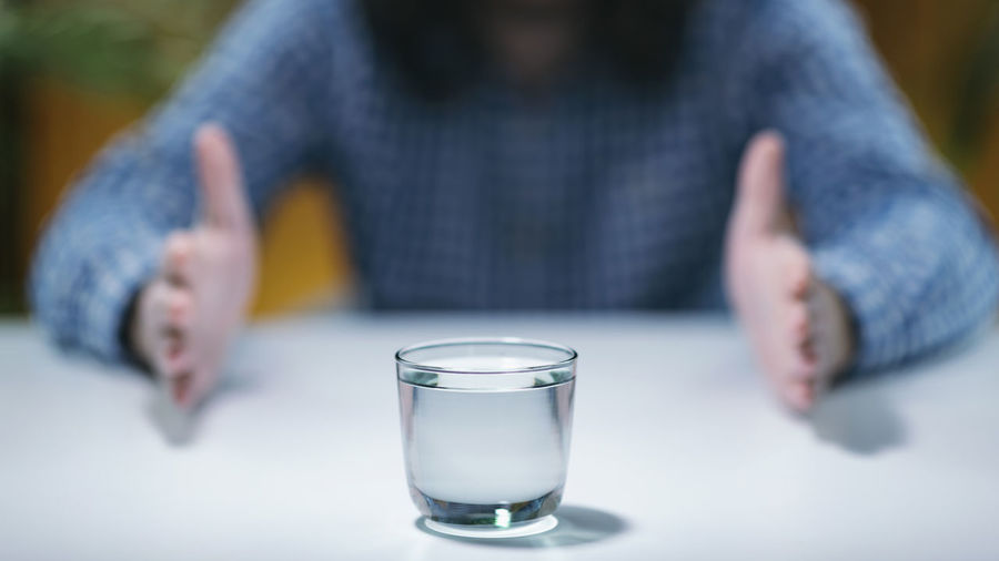 Close-up of glass of water on table