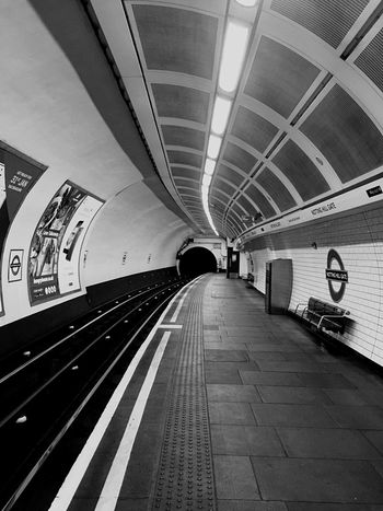 Indoors  Transportation Subway Station The Way Forward Architecture Rail Transportation Built Structure Public Transportation Illuminated Tunnel Moving Walkway  Day United Kingdom London EloEmenike Black And White Telling Stories Differtenly Abstract EyeEmNewHere