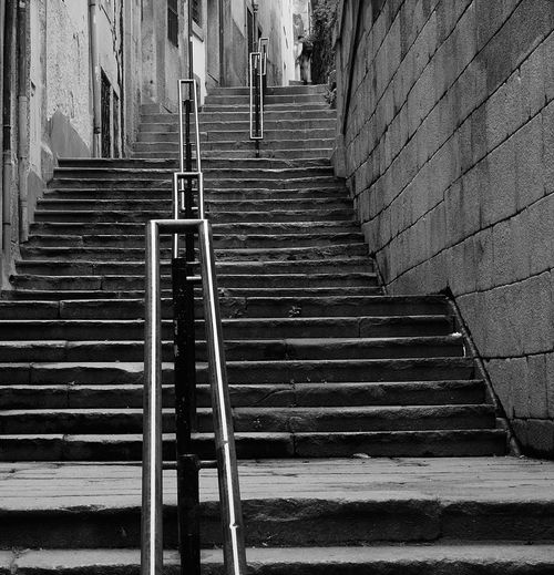 Low angle view of steps by buildings