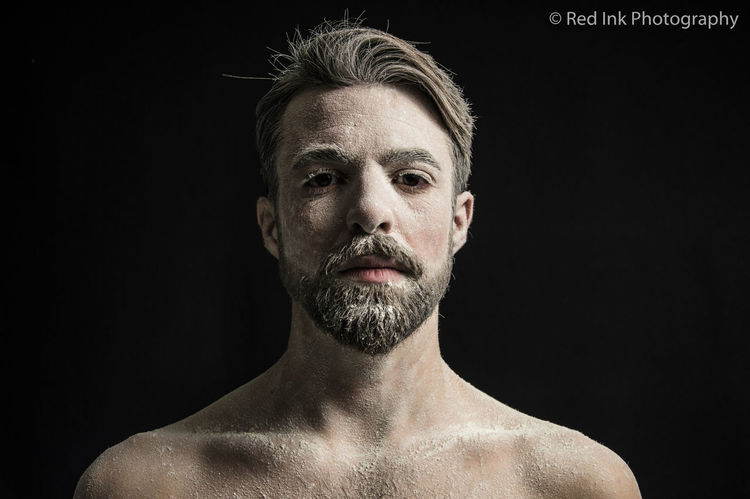 Attitude Beard Black Background Copy Space Darkroom Front View Headshot Human Face Looking At Camera One Mid Adult Man Only Portrait Serious Studio Shot Young Adult