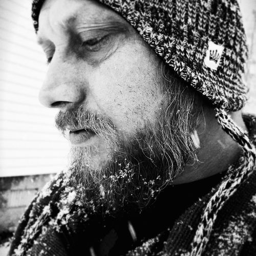 Close-up of bearded man during winter