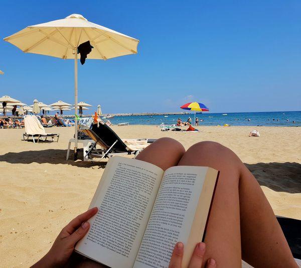 Reading Reading A Book Water Sea Sand Dune Low Section Beach Clear Sky Relaxation Sand Summer Human Leg Beach Umbrella Parasol Sunshade Outdoor Chair