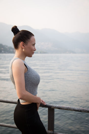 Young beautiful woman standing looking at the lake Adult Beautiful Beautiful Woman Beauty Como Cruise Enjoying Life Female Feminine  Healthy Lifestyle Italy Lifestyles Nature One Person One Woman Only Profile View Sea Sensual_woman Side View Style Summer Summertime Woman Portrait Women Young Adult