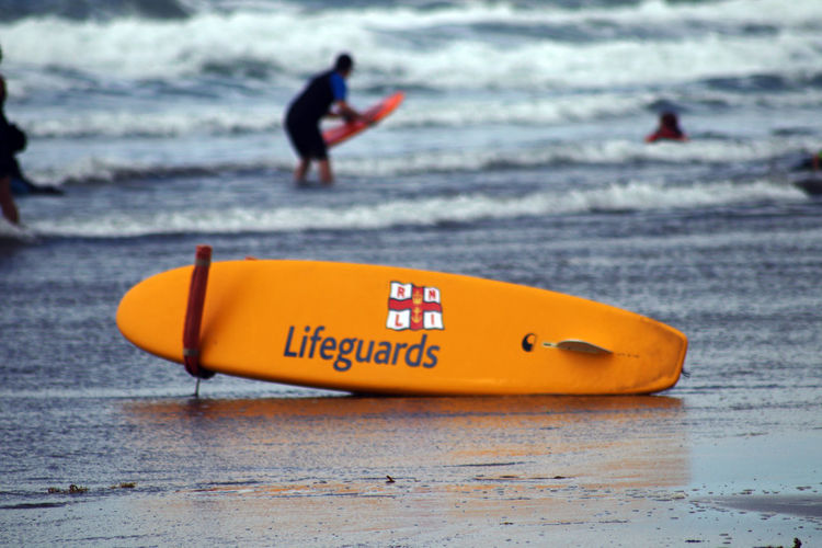 View of a surfboard on beach