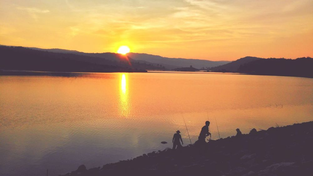 Reflection Orange Color Sunset Sunlight Morning Mountain Lake Silhouette Sun Sky One Person Landscape Adventure Nature Fishing Outdoors Tranquility People Scenics Adult Thailand Photos Thailandtravel Loei,thailand