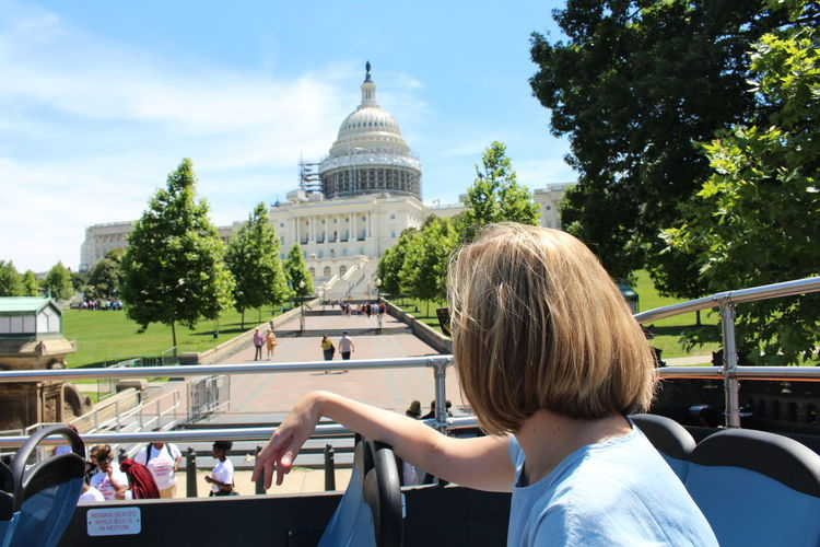 Woman on bus in front of capitol building