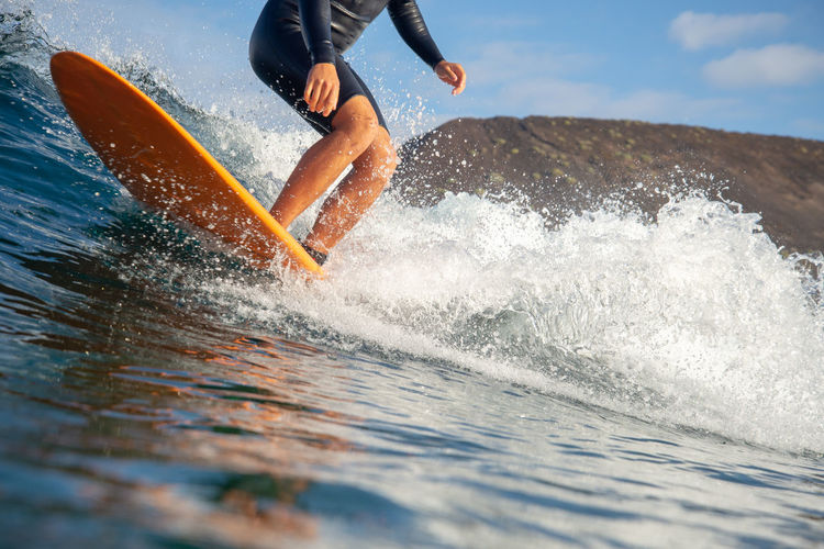 Motion Sport Water One Person Real People Lifestyles Sea Leisure Activity Splashing Nature Wave Day Low Section Aquatic Sport Sky Extreme Sports Adventure Human Leg Skill  Outdoors