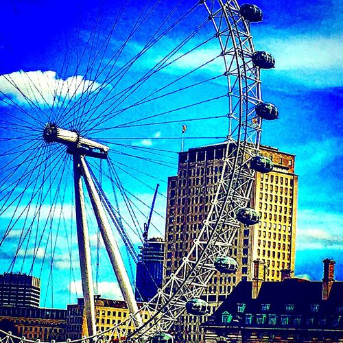 Low Angle View Architecture Built Structure Sky Blue Outdoors Day No People Building Exterior Ferris Wheel City Skyscraper Cityscape London Eye, London British England, UK EyeEm LOST IN London