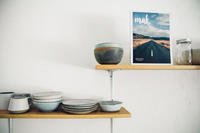 Stack of bowls on table against wall at home