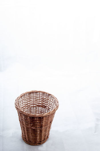 High Angle View Of Empty Whicker Basket On White Background