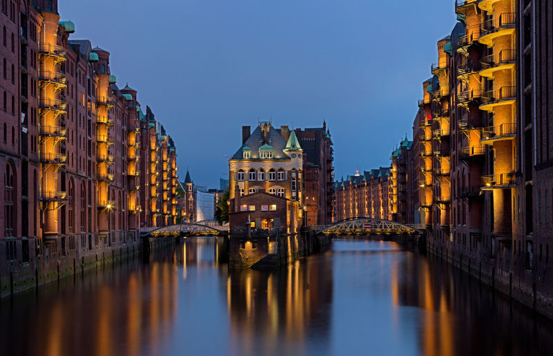 Free and Hanseatic City of Hamburg. Free And Hanseatic City Free And Hanseatic City Of Hamburg Hamburg Hanseatic City Speicherstadt Hamburg Architecture Blue Bridge Bridge - Man Made Structure Building Building Exterior Built Structure Canal City Clear Sky Connection Dusk Illuminated Nature No People Outdoors Reflection Residential District Sky Speicherstadt Water Waterfront