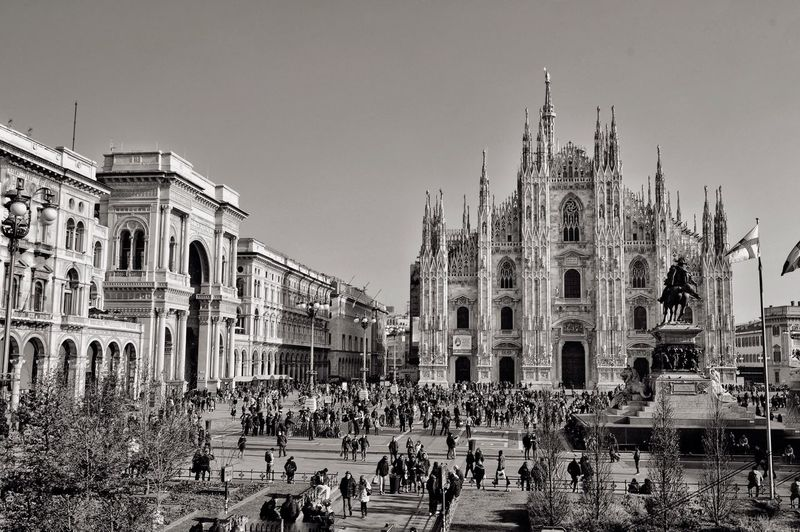 People in front of duomo di milano at piazza del duomo against sky