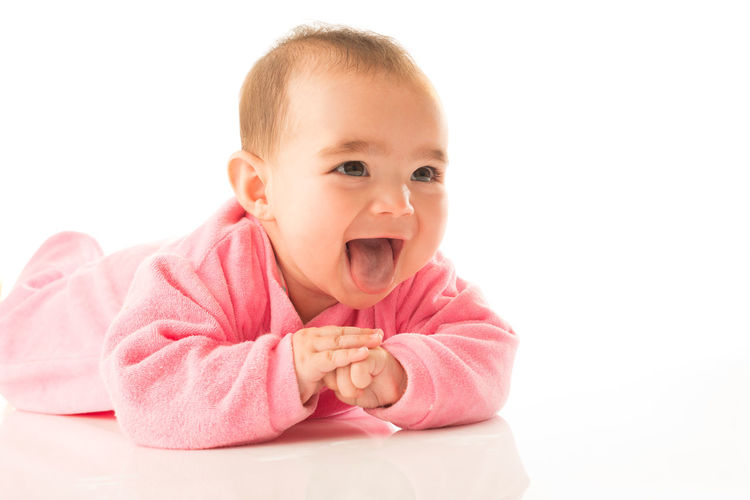 Portrait of cute baby against white background