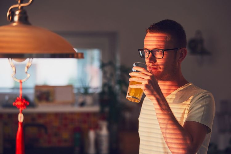 Morning time at home. Pensive man drinking juice in the kitchen. Alone Contemplation Domestic Life Home Man Morning Morning Light Pensive Shadows & Lights Sunlight Thinking Day Dreaming Drinking Drinking Glass Eyeglasses  Glass Jalousie Kitchen Lifestyles One Person Orange Juice  Real People Shadow Single Waist Up