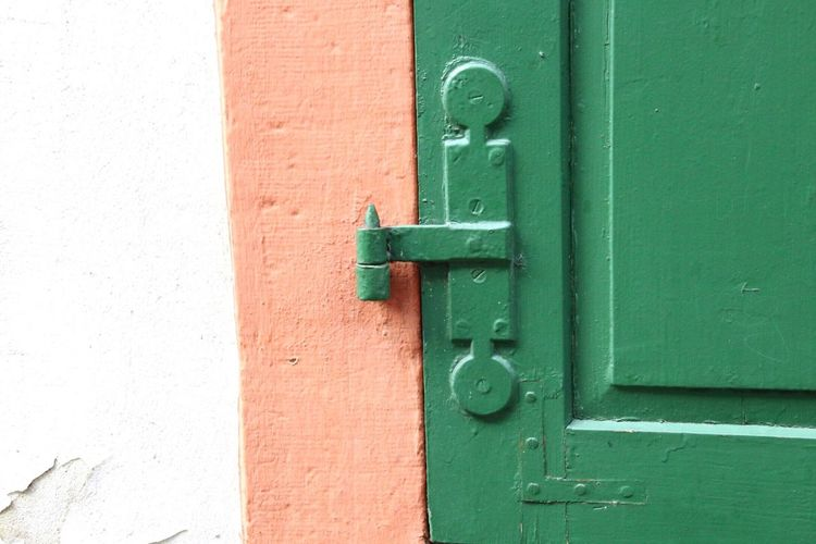 Close-Up Of Metallic Hinge On Door