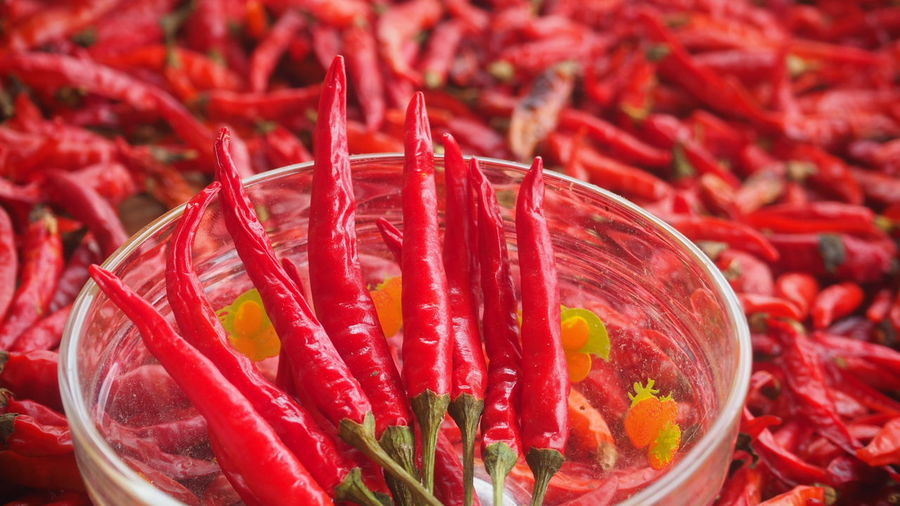 Close-Up Of Red Chili Peppers For Sale At Market Stall