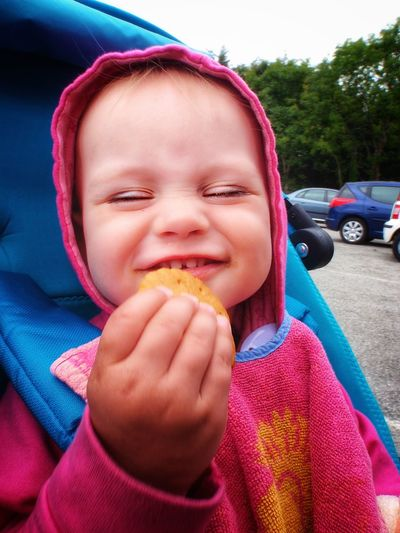 Baby Children Pink Biscuit Eating Smiling Looking Camera