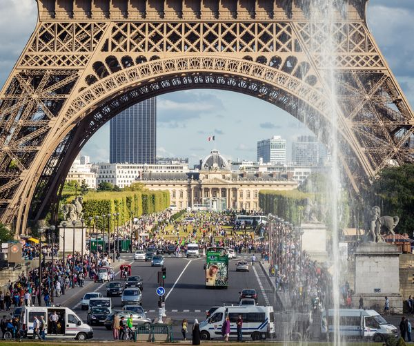 Eiffel Tower Architecture Built Structure Transportation Building Exterior Land Vehicle Mode Of Transportation City Tourism Incidental People Outdoors Large Group Of People Motor Vehicle