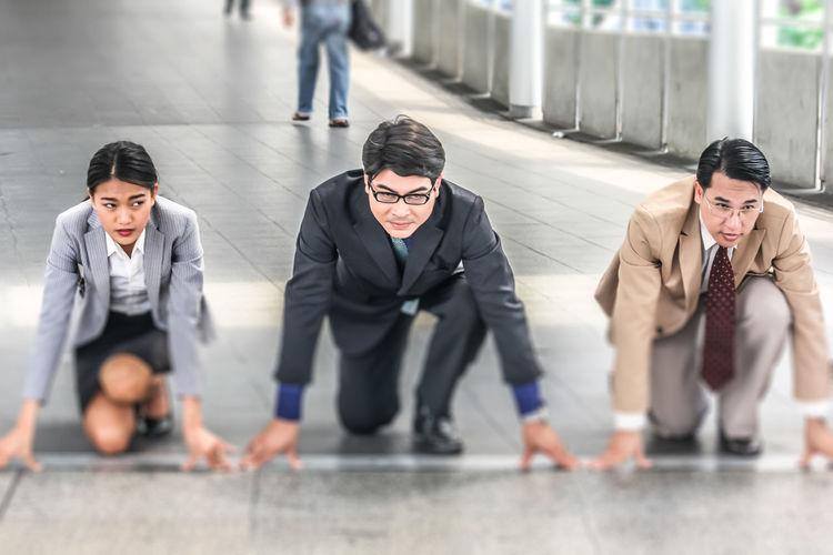 Colleagues preparing to run on bridge
