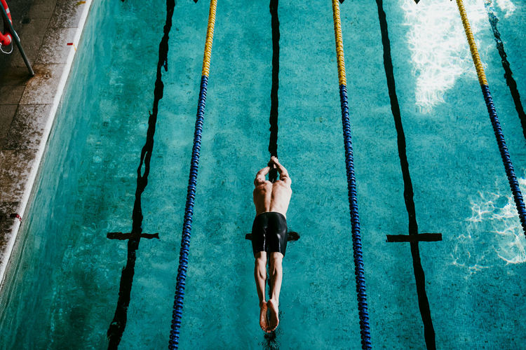 High angle view of men swimming in pool