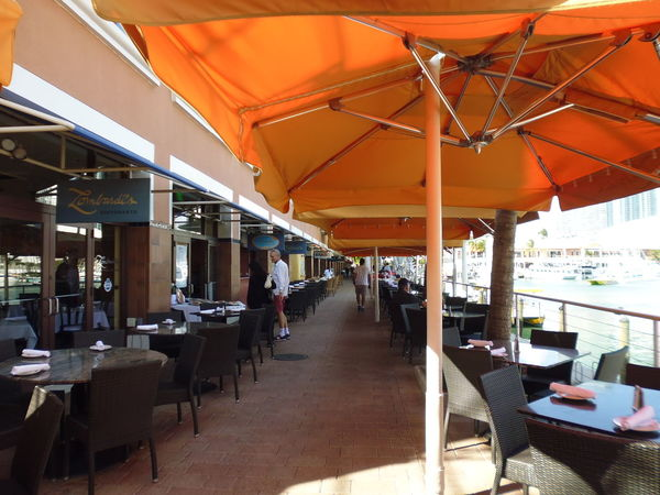 Open Air Restaurant - Bayside Marketplace Centered Angle Susan A. Case Sabir Unretouched Photography Architecture Awning Centered Perspective Chair Day Empty Focal Point Food And Drink Establishment In A Row Open-air Restaurant Outdoor Cafe Outdoor Restaurant Ready For Business Real People Restaurant Table Tropical Climate Tropical Restaurant