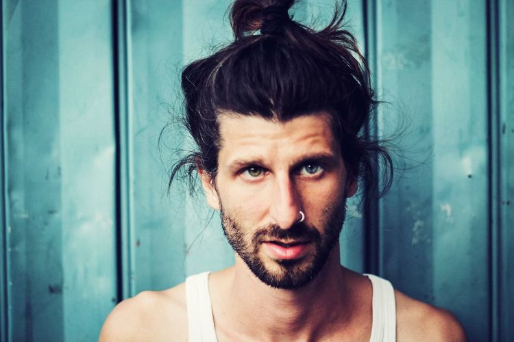 young man with long hair and stylish beard Nose Piercing Blue Background Manbun Tank Top Male Model EyeEm Selects Headshot Real People Looking At Camera One Person Portrait Front View Beard Day Lifestyles Close-up Young Adult Adult Adults Only This Is My Skin The Portraitist - 2018 EyeEm Awards