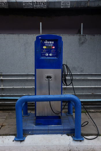 Automatic air compressor in a petrol station in Thailand. Air Compressor Automatic Blue Day No People Outdoors Petrol Station Pumper Rubber Hose Thailand
