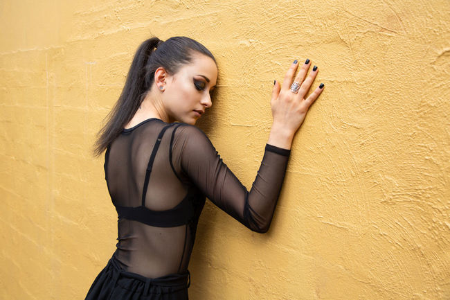 Neisha Architecture Arms Raised Beautiful Woman Beauty Built Structure Day Fashion Photography Hairstyle Human Arm Lifestyles One Person Real People Standing Three Quarter Length Waist Up Wall - Building Feature Women Yellow Yellow Color Young Adult Young Women The Fashion Photographer - 2018 EyeEm Awards