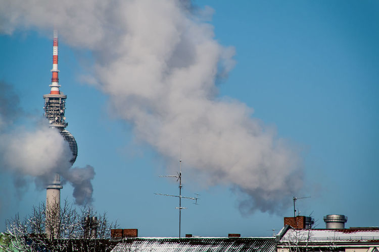 Fernsehturm Covered With Smoke By Industry Against Clear Blue Sky