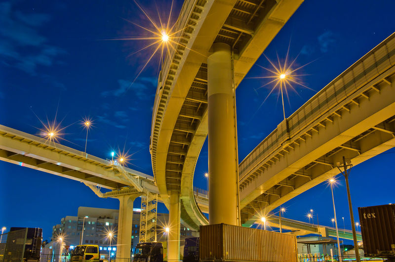 Illuminated Architecture Built Structure Sky Low Angle View Night Connection Street Light Building Exterior No People Lighting Equipment Bridge Lens Flare City Light Beam Glowing Bridge - Man Made Structure Street Blue Outdoors Light Office Building Exterior Skyscraper Japan Highway
