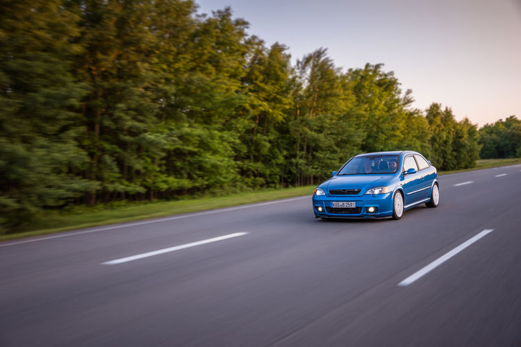 Cars Nature OPC Opel Astra Blue Car Opel Astra Rolling Shot Street