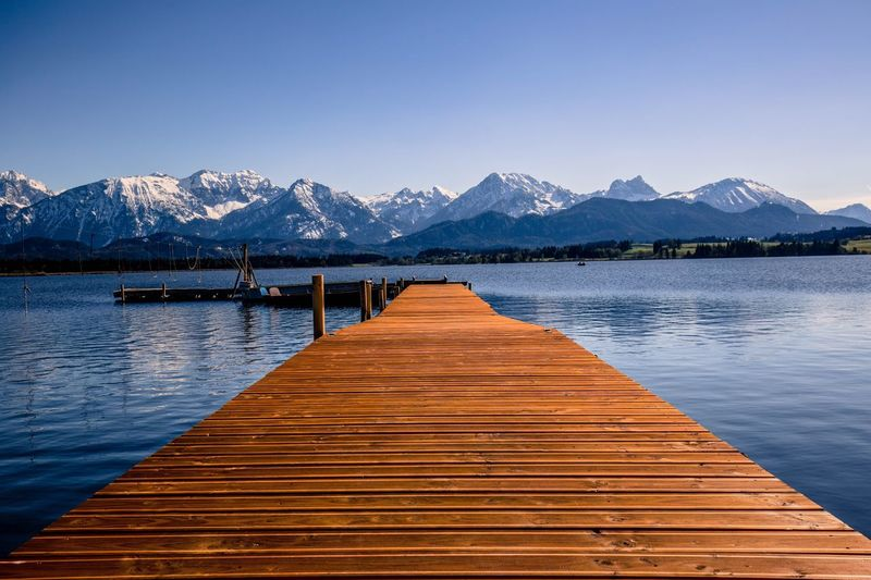 Mountain Mountain Range Lake Nature Beauty In Nature Scenics Clear Sky Snow Tranquility Blue Pier Winter Tranquil Scene Water Outdoors No People Cold Temperature Day Snowcapped Mountain Travel Destinations