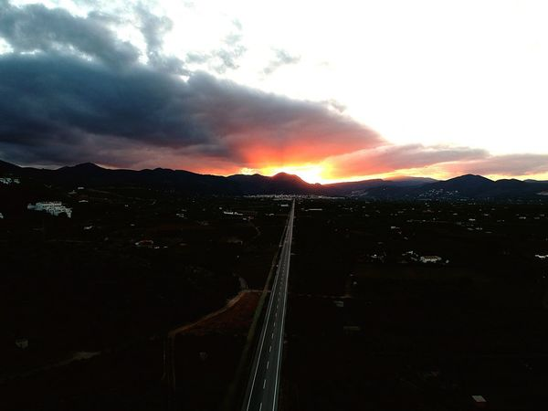 Drone shot over the road to Pego in Spain. Mountain Beauty In Nature Sky Nature Sunset Scenics No People Tranquil Scene Cloud - Sky Tranquility Outdoors Landscape Mountain Range Day Farm Beauty In Nature Dronephotography Droneshot Drone Moments Tranquility Rural Scene Field Agriculture Close-up
