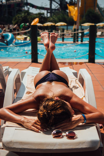 Beautiful Woman Bikini Holiday Leisure Activity Lifestyles Lying Down Nature One Person Outdoors Pool Real People Relaxation Summer Swimming Pool Swimwear Trip Vacations Water Young Adult Young Women